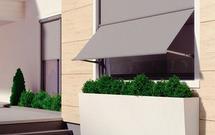 Jak ochronić wnętrze domu przed przegrzaniem? Żaluzje, markizy tarasowe, rolety okienne